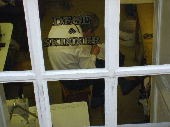 A tailor hard at work in Dege and Skinner's workshop